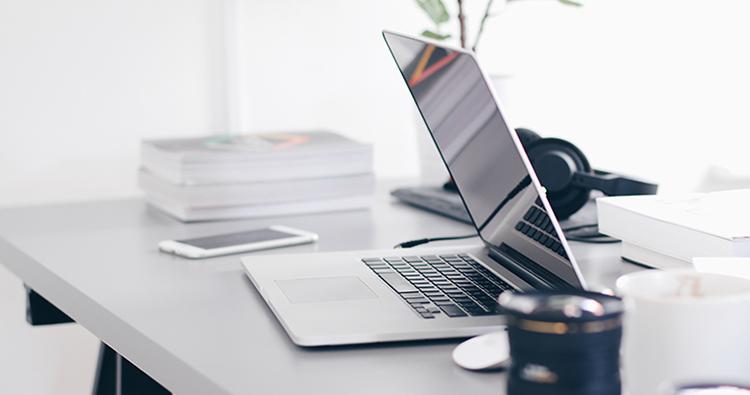 Laptop half open on a desk